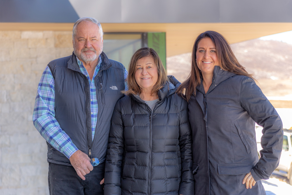portrait of custom builders John, Kate and Nicole Shively